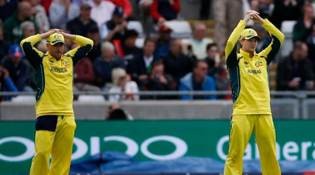 Australia's Aaron Finch and Steve Smith (right) look dejected